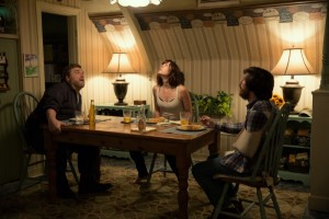 John Goodman as Howard; Mary Elizabeth Winstead as Michelle; and John Gallagher Jr. as Kyle in 10 CLOVERFIELD LANE; by Paramount